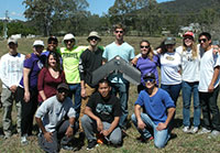 Students studying robotics in Australia pose in flying test field