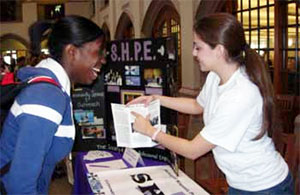 two women looking at brochure at Engineering Societies Fair