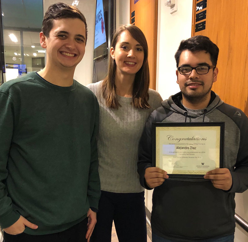 From 2017-2018, Lead EPE Sam Najmolhoda, Lauren Fryhle, Lead Academic Adviser, and Alejandro Diaz, Outstanding EPE award