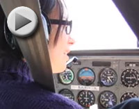 Michelle Rogers in pilot seat of airplane
