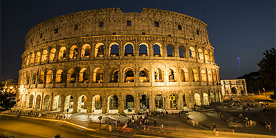 the Colosseum illuminated at night
