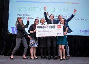 BioPots accepting the $15,000 Wells Fargo prize for their biodegradable planter pots made from biomass waste