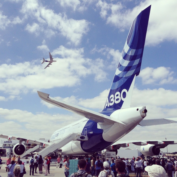 From the Paris International Airshow: an Airbus A380 performing jumbo jet aerobatics overtop of... another Airbus A380
