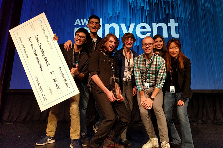 picture of student team with award check