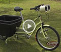 bike with cargo bin, lights, electric assist, tunes