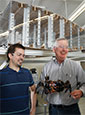 Boeing engineers Lance McCann and Jim Buttrick with a robotic device
