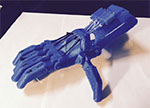 a blue, 3-D printed prosthetic hand