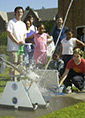 children watch a water rocket blast off