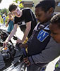 UW student shows middle school students EcoCAR engine (photo by Ellen Banner, Seattle Times)