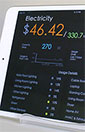 iPad shows results displayed via energy monitoring app