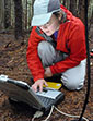 Susan Dickerson-Lange measures snow levels in PNW forests