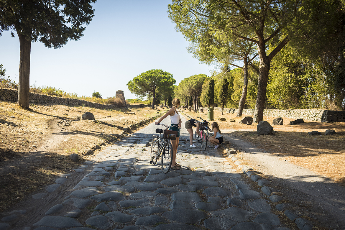 students cycling on Appian Way