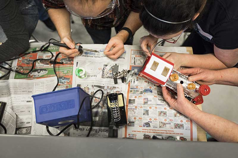 photo from above of students soldering