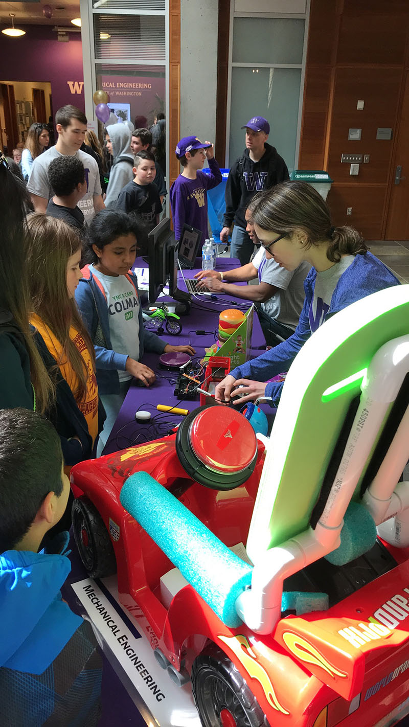 photo of students examining toys