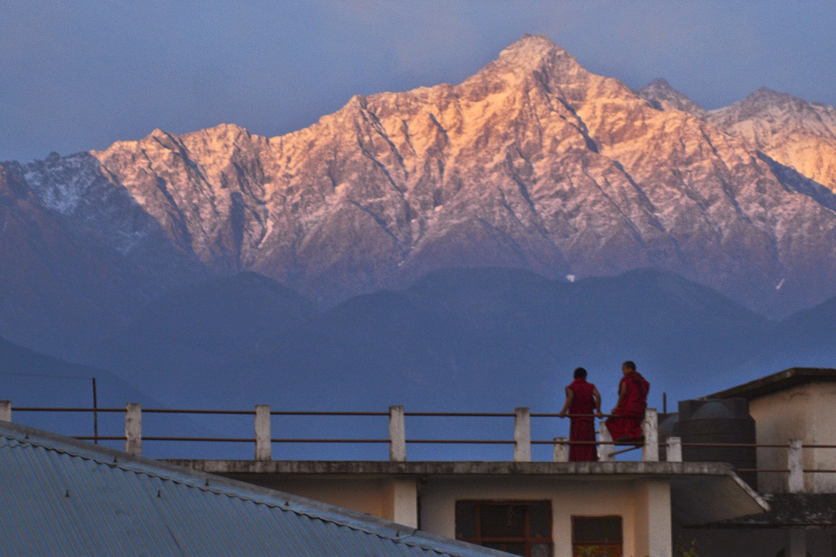 photo of monks at sunset