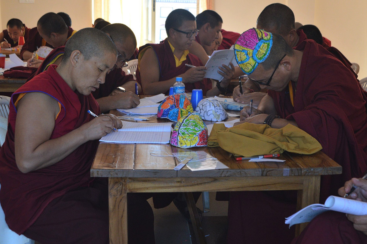 photo of monks working on brain hats