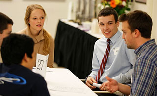 students and Career Center staff talking at a table