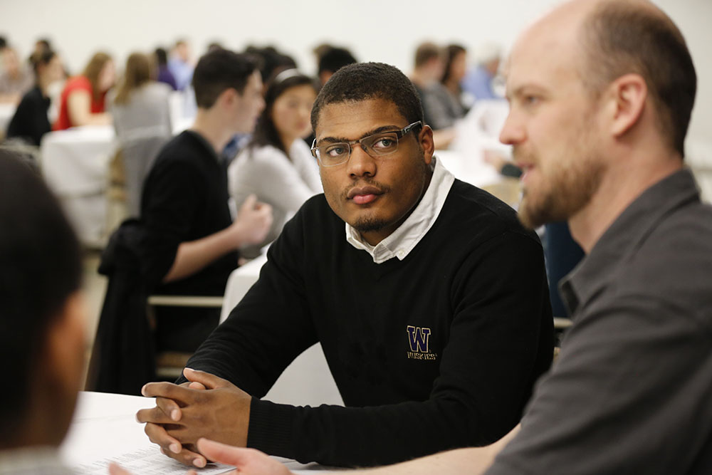 Student listening at a career event
