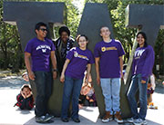 STEM Bridge students standing in front of giant W
