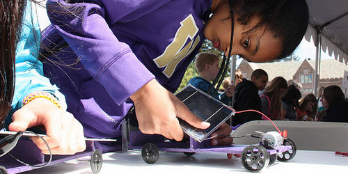 girl working on solar car experiment