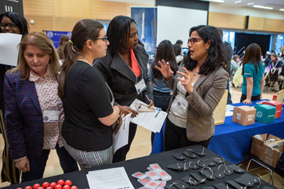 Students chatting with employers at WiSE Conference Career Resource Fair