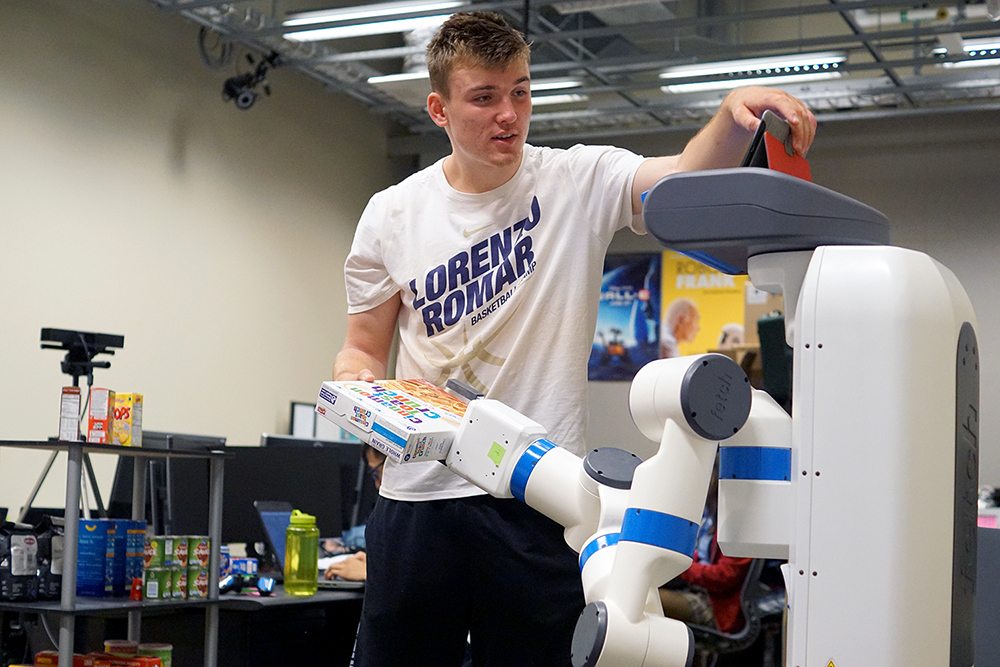 image of student with assistive robot