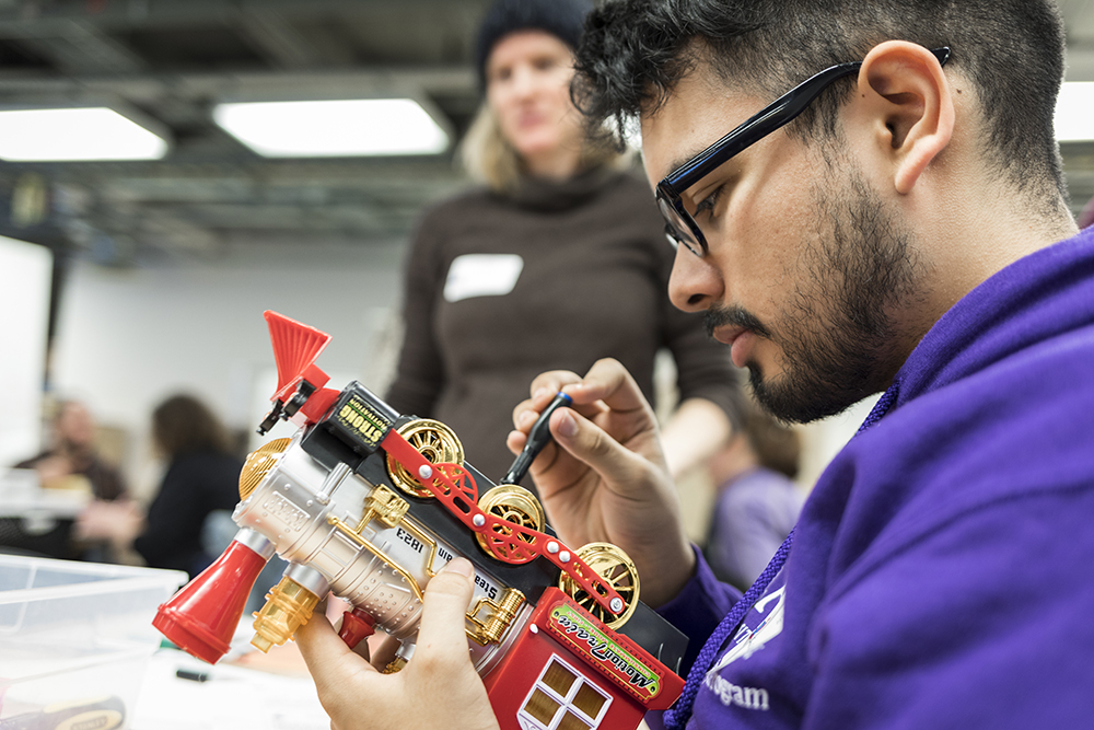 image of students reconfiguring toys