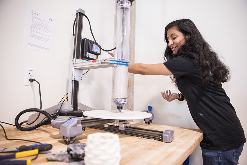 a student with the Potterbot Ceramic 3D printer