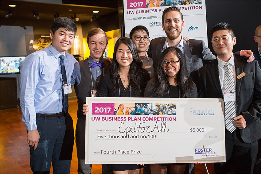 group of students holding a big check