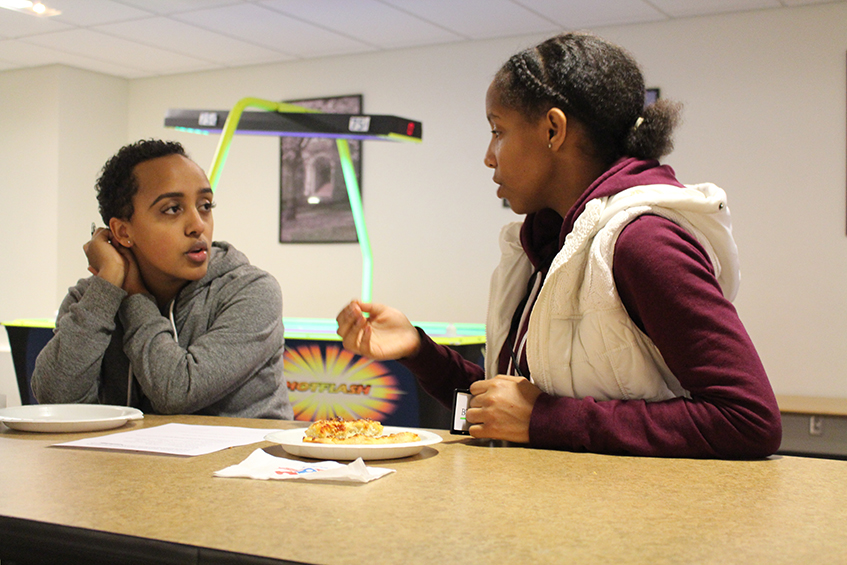 Melaku mentoring high school student at Women's Center.