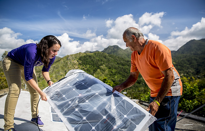 Researchers installing solar panels