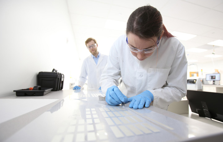 Clean tech workers in lab