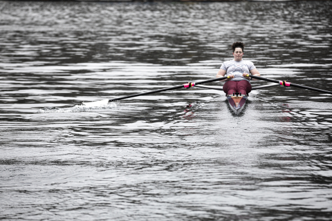 Sam Kolovson rowing on a lake