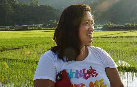 a woman standing outside in a field