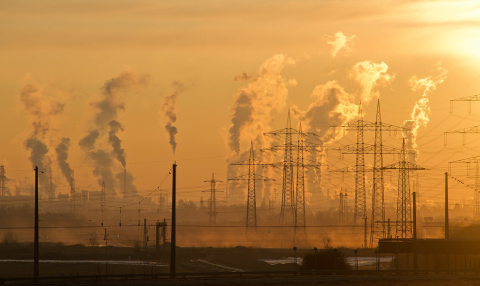 A picture of power lines at sunset. Everything is hazy.