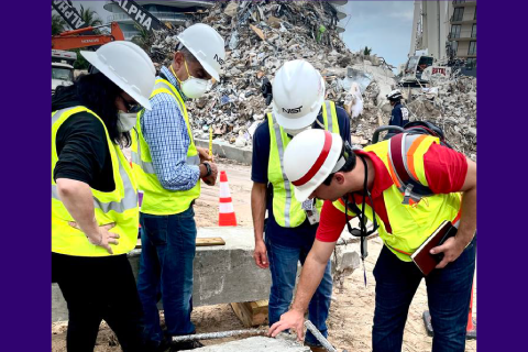 NIST and U.S. Army Corps of Engineers staff members inspect a building element from the Champlain Towers South partial collapse in Surfside, Florida, for its evidentiary potential.