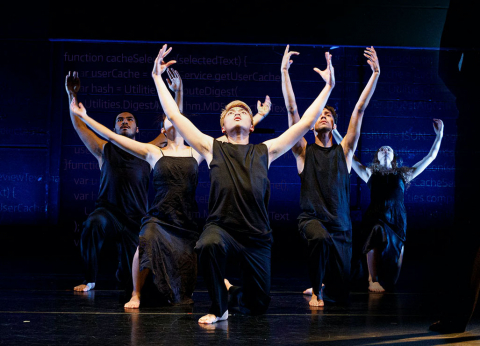 A group of students dancing on stage