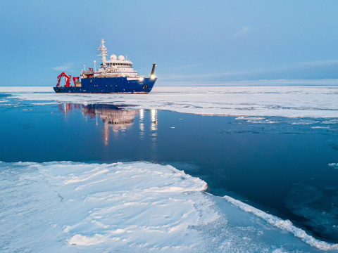 A ship breaking a path through sea ice