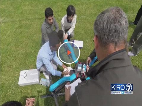 Students tweaking a drone