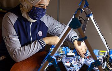 Rania Hussein working with a circuit board