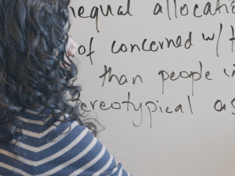 person writing on a whiteboard