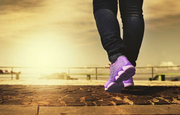 photo of person's legs and exercise shoes walking