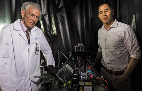 UW researchers with 3-D microscope
