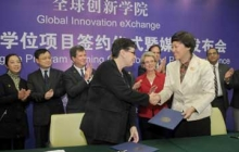 UW President Ana Mari Cauce shakes hands with Tsinghua University Chairperson Chen Xu after signing an agreement creating a dual degree program within the Global Innovation Exchange (GIX). Photo credit: Dan Schlatter