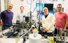 Instrument built by UW engineers (from left) Peter Pauzauskie, Xuezhe Zhou, Bennett Smith, Matthew Crane and Paden Roder (unpictured) used infrared laser light to refrigerate liquids for the first time. Credit: Dennis Wise/University of Washington