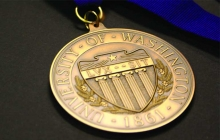 gold colored award medal