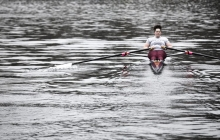 a person rowing in water