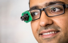 man wearing low-power, video-streaming prototype camera; photo by Dennis Wise/UW