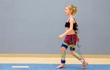 demonstration of child walking, wearing electromyography (EMG) data sensors.