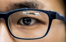 University of Washington graduate student, Jinyuan Zhang, demonstrates how wearable sensors can track eye movement. Credit: Dennis R. Wise/University of Washington